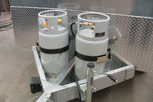 Somersong Forge Trailers:  Propane Tanks with Brackets and Gauges -Heavy-duty coupler shown here with [2] 33 lb tanks -Purchase LP by the gallon and save!