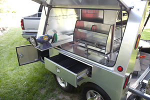 Somersong Forge Trailers:  All Optional Features Include: -Multidirectional tool slide -Side out drawers -Aluminum wheels -Deck top product storage bin