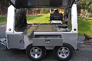 Somersong Forge Trailers:  Close-up of Options: -Side marker lights and aluminum wheels -Side out drawers and product compartment